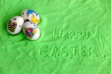 eggs green sand background