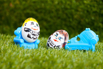 little egg fellows enjoy on sofa and armchair outdoors