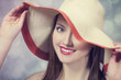 Beautiful girl in hat at bokeh background