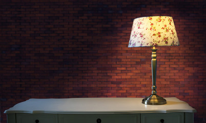 big brick wall and light lamp on white table