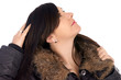 Woman in winter jacket lokking to sky