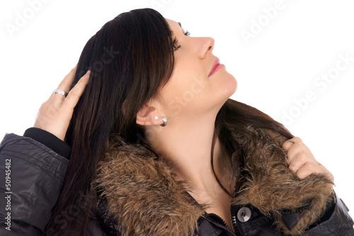 Woman in winter jacket lokking to sky