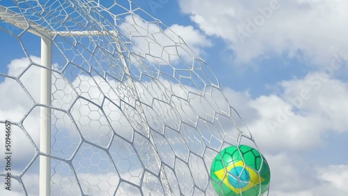 Brazilian Ball Scores in Slow Motion with Sky Background