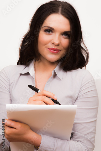 Young professional female with pen and pad