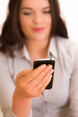 Young female model interacting with iphone smartphone device