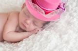Newborn Baby Girl Wearing a Fancy Pink Hat