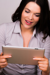 Professional female enjoying ipad tablet device