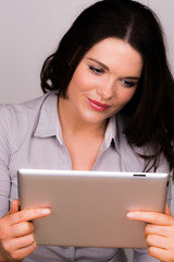 Professional female reading ipad tablet device