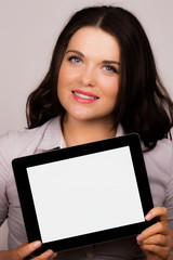 Beautiful female presenting ipad tablet device screen