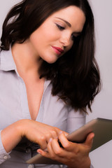 Professional female using ipad tablet device