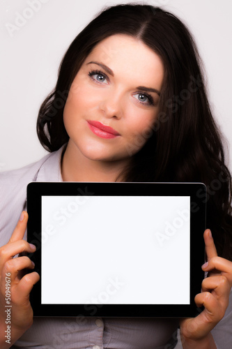 Young female presenting ipad tablet device screen