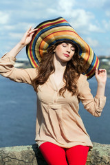 Young brunette in colorful hat