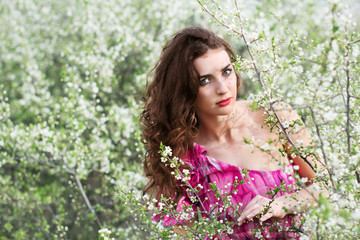 Brunette in flowering trees