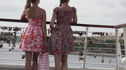 Girlfriends with shopping bags on the bridge