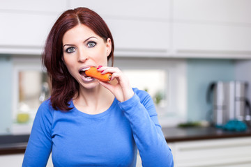 attractive female eating carrot