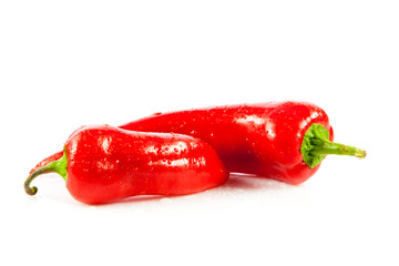 Red hot chili peppers on white background.