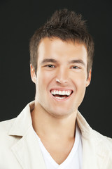 smiling young man in white shirt