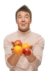 young man with oranges and apples