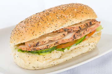 Chargrill Chicken & Salad Sandwich on a white background