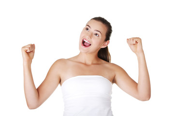 Excited teen woman with fists up