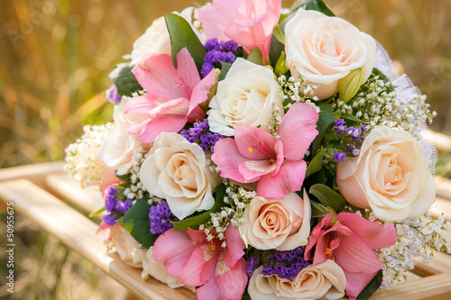 bouquet of the bride executed from light pink and beige roses