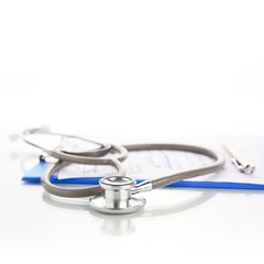 Stethoscope with blue medical clipboard