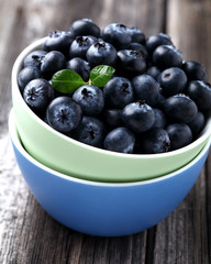 Fresh ripe blueberries in the colored plates