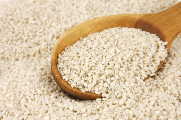 Sesame seeds in wooden spoon