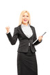 Young professional woman holding a clipboard and  gesturing happ