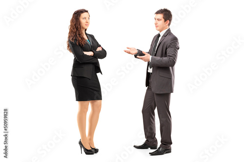 Full length portrait of a young businesspeople having a conversa