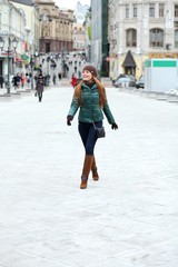 Full length, Walking woman in autumn Moscow street