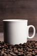 cup of coffee and beans on brown wooden background