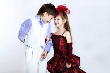 Little girl in beautiful dress and boy