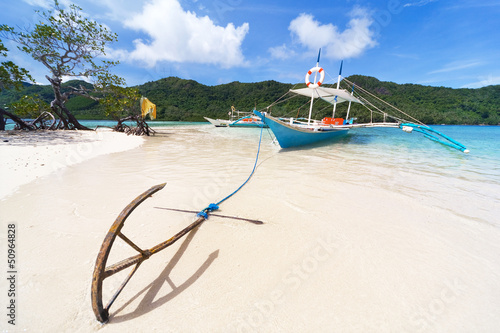 The boat with the anchor on the beach