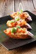 Bruschetta with mozzarella and tomato. Selective focus