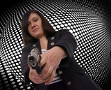 woman with handgun with grid background