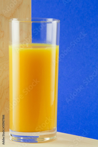 A glass with orange juice