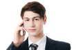 The businessman in business suit speaks by phone