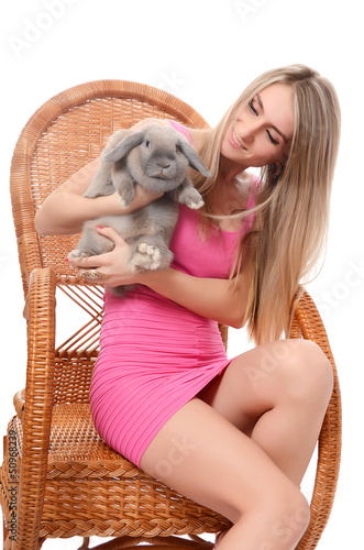 The beautiful woman with a grey rabbit