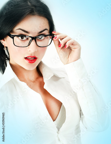 Portrait of beautiful young woman in business office suit