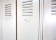 Empty white school metal lockers
