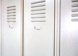 Empty white school metal lockers