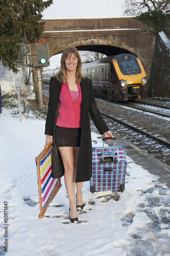 Holidaymaker departing the cold English weather by train