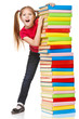Schoolgirl holding pile of books. Isolated