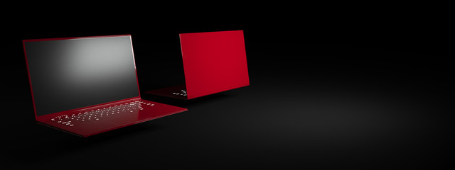 red laptop on a black background