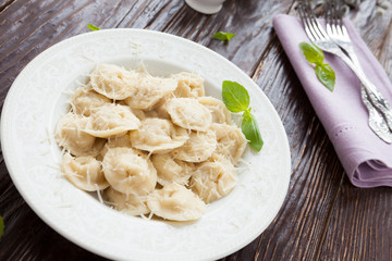ravioli with grated parmesan cheese
