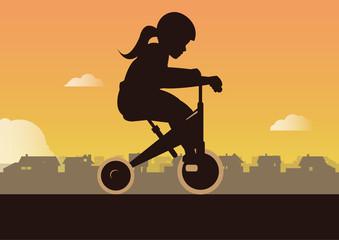 Mädchen mit Dreirad