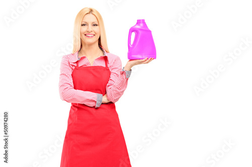 Housewife  holding a bottle of detergent and posing
