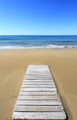 Wooden floor on golden sandy beach