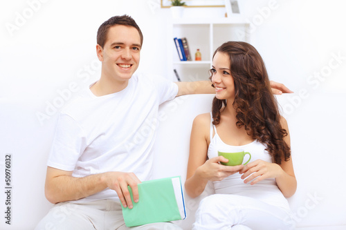 Young happy couple at hone together s